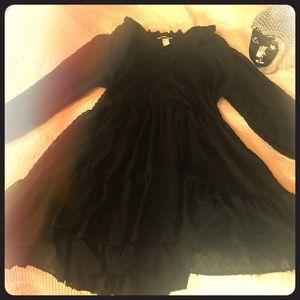 Short shear ruffled black dress with lining.